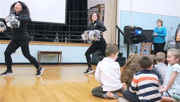 Teacher, Syracuse Silver Knights dancer inspires students
