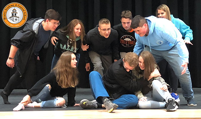 The cast of 'The Legend of Sleepy Hollow' rehearses on the high school stage.