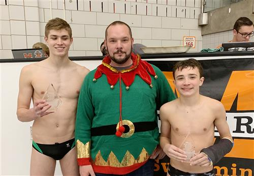 A Mexico faculty member poses with boys swimming MVPs after a recent meet