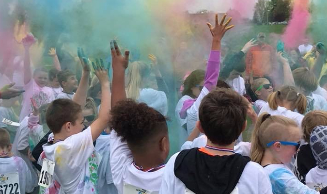 Pictured are students and parents participating in a previous color run.