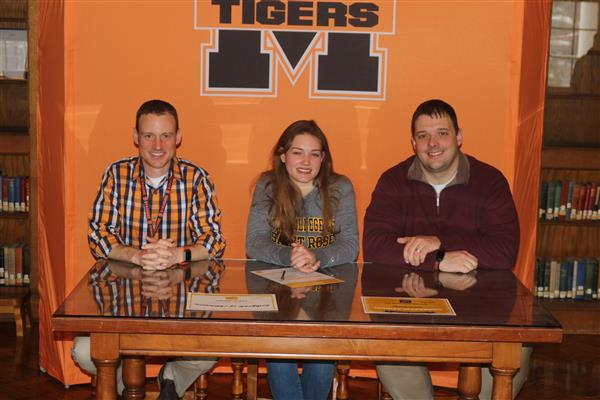 Harriger pictured with MACS music staff on signing day