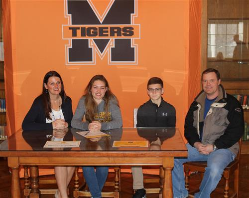 Victoria Harriger pictured with her family after signing for Saint Rose's music program