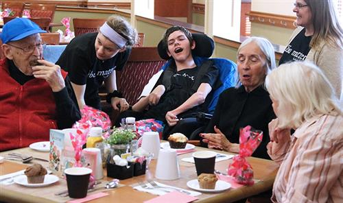 Students socialize with residents of St. Francis Commons in Oswego.