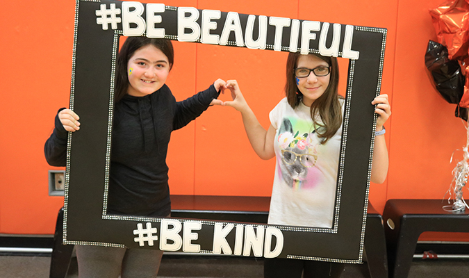 Two students pose with a prop during True Beauty Day at Mexico Middle School.
