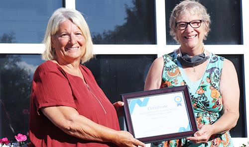 Darlene Upcraft (left) is recognized as Oswego County Board Member of the Year.