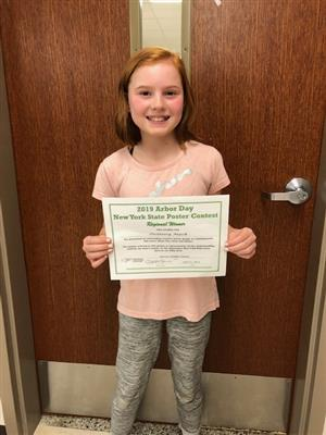 Delaney Mack is pictured with her certificate of achievement