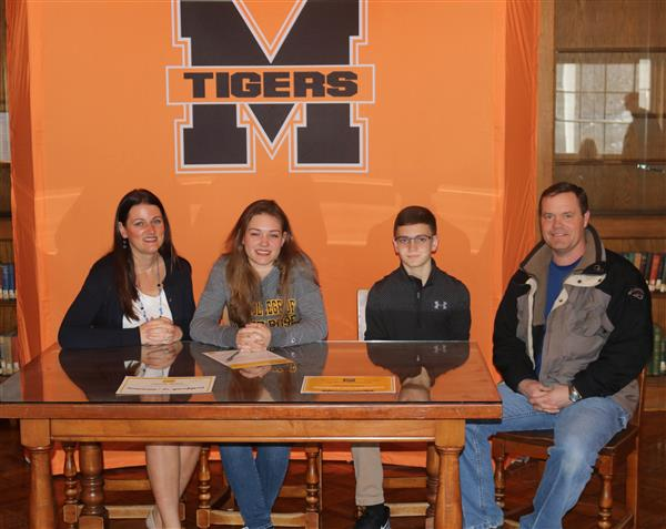 Victoria Harriger is pictured with her family at a recent signing ceremony for her.