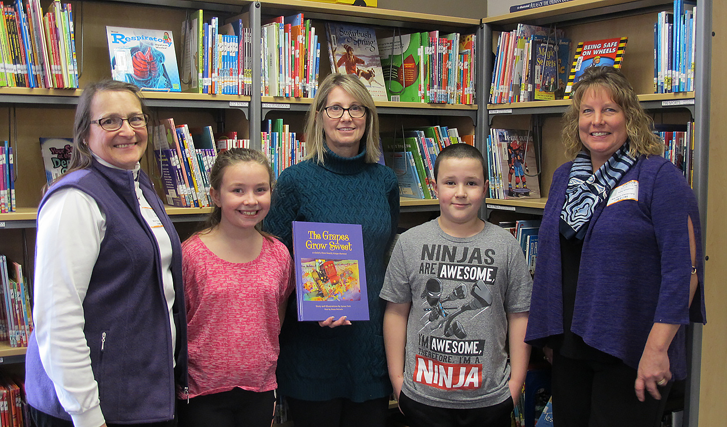 New Haven Elementary School Library Teacher Kelly Culler, center, with Agricultural Literacy Weeks Volunteers Joleen Walther