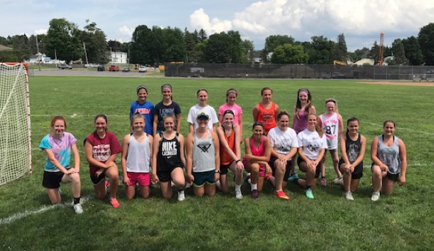 MACS Lacrosse camp 2017 participants pose on the field for a picture